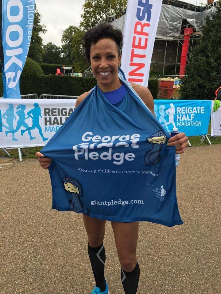 Dame Kelly Holmes wearing a cape
