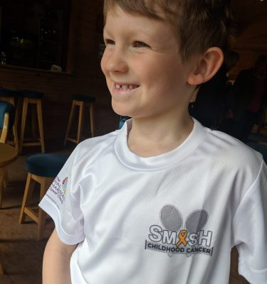 George wearing Smash Childhood Cancer tee